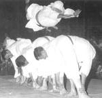 photo of Soke Morton leaping over several senior members